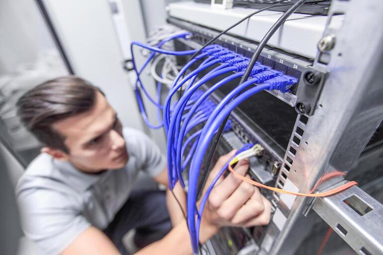 Man working in network server room
