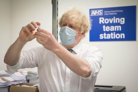 Boris Johnson with the AstraZeneca vaccine