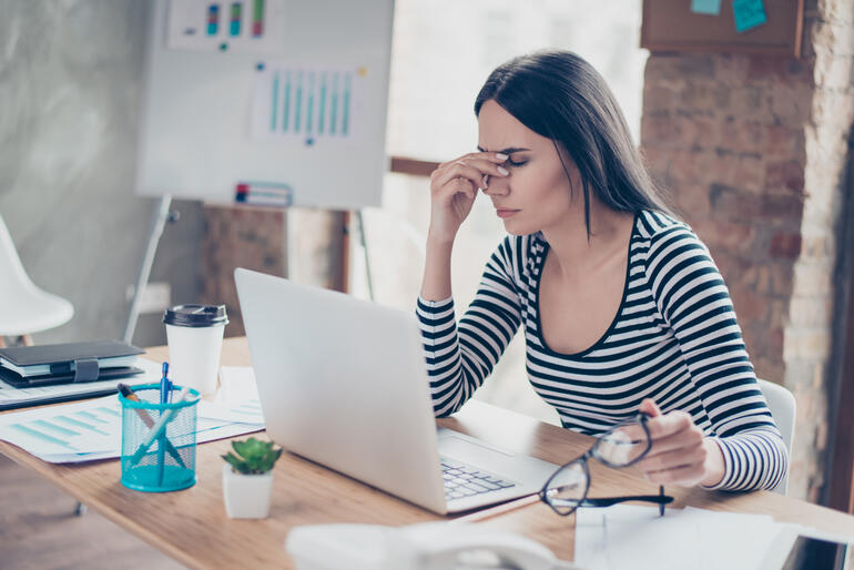 Woman at desk, worried