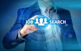 businessman pressing job search button on virtual screens