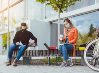 masked-man-and-woman-on-campus.jpg