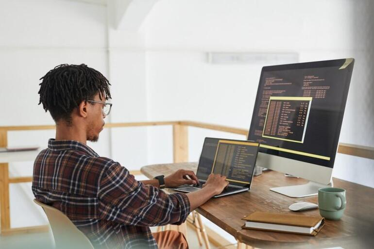 young-man-remote-working-from-home-coding-programming-language.jpg
