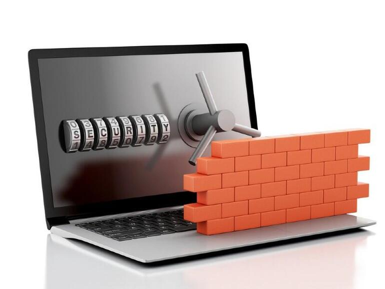 A wall in front of a computer