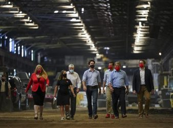 Liberal Leader Justin Trudeau, centre, along with Liberal candidates, makes a campaign stop at a steel plant during the Canadian federal election campaign in Welland, Ont., Monday, Sept. 6, 2021. THE CANADIAN PRESS/Nathan Denette