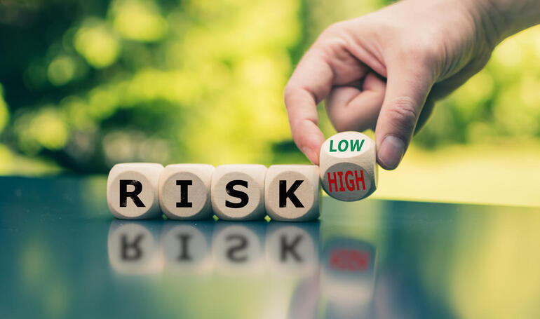 Symbol for reducing a risk. Cubes form the word