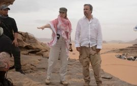 """This image released by Warner Bros Pictures shows executive producer Tanya Lapointe with director Denis Villeneuve on the set of """"Dune."""" THE CANADIAN PRESS/AP-Chia Bella James/Warner Bros. via AP"""